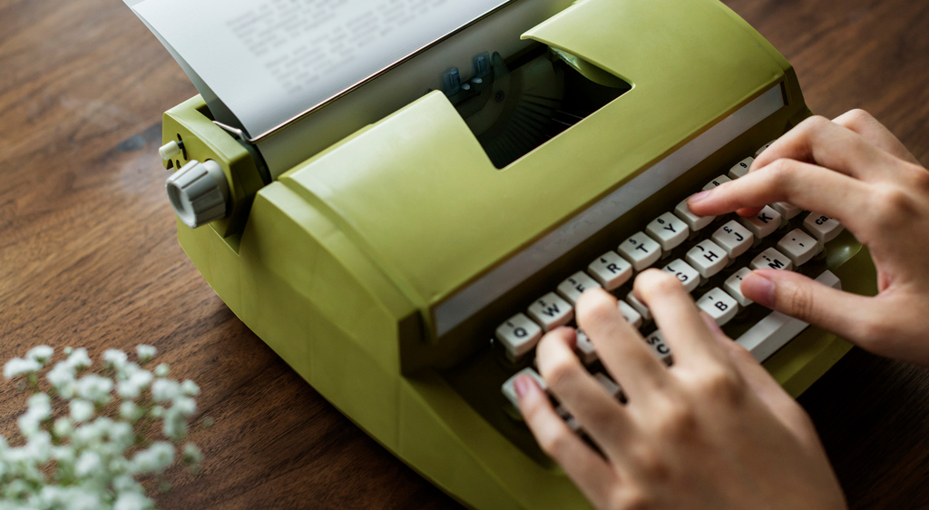 A typist composing a letter