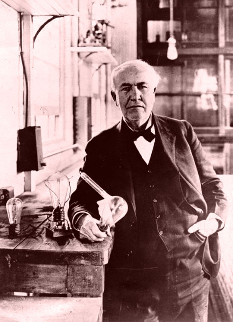 Thomas Edison in his laboratory posing with his invention - the Light Bulb
