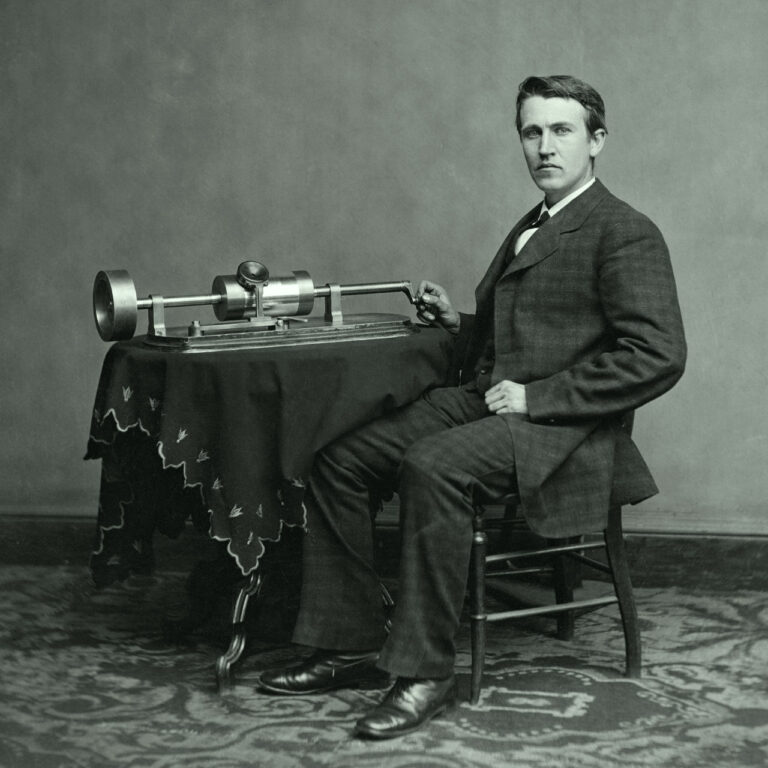 A confident Thomas Edison posing with his phonograph