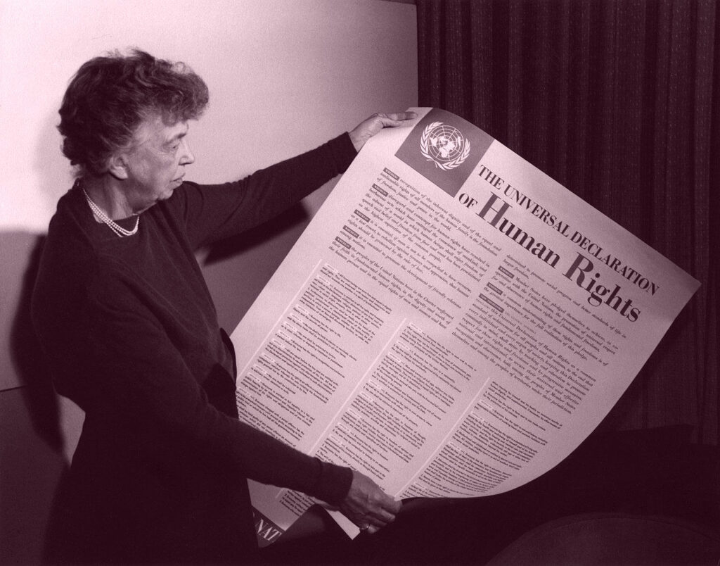 Eleanor Roosevelt displaying the poster of the Universal Declaration of Human Rights