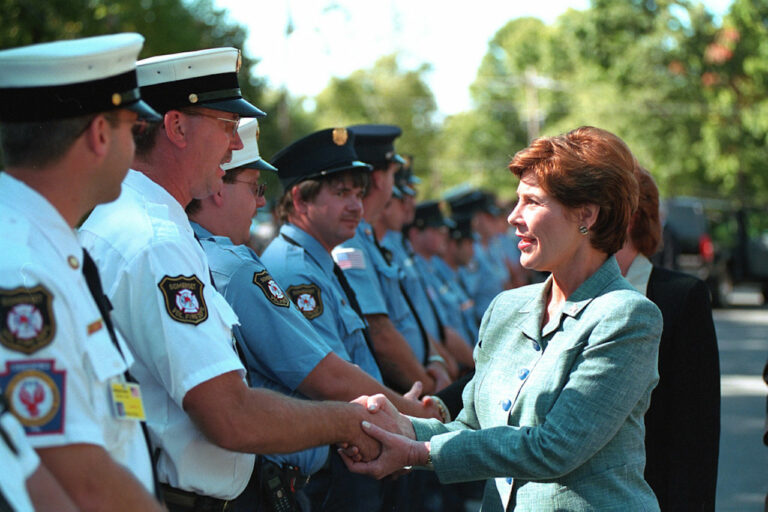 Laura W. Bush greets firefighters and police.
