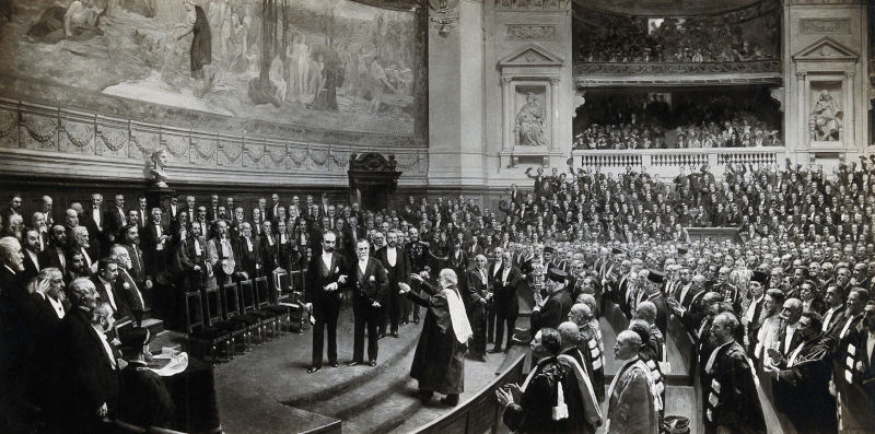 Photograph after a painting by Jean-André Rixens. Louis Pasteur acclaimed amidst a dignified crowd