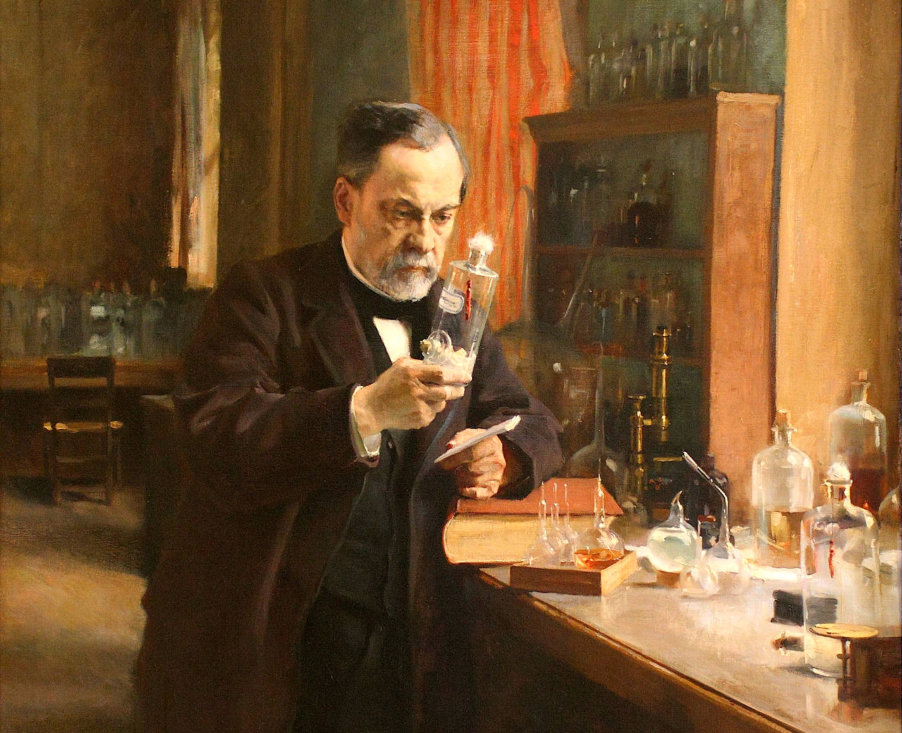 Louis Pasteur in his laboratory; leaning on the work table which has chemicals and apparatus