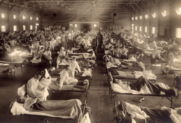 A big room lined up with patients in bed